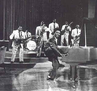 little richard with leg on piano again